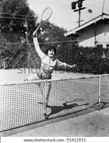 female tennis player reaching...