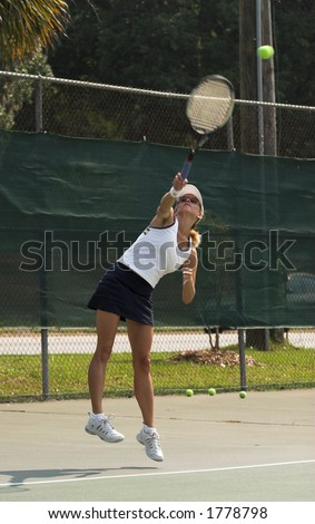 Female tennis player returning ball