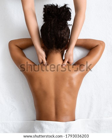 Female therapist massaging black woman neck, top view, spa concept Photo stock ©