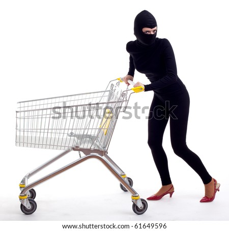 female thief in black clothes and balaclava with shopping cart