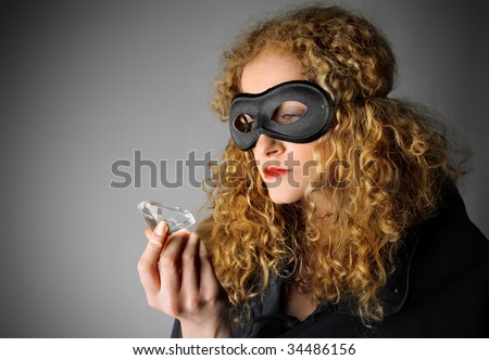 female thief stealing a diamond