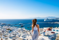 Female tourist looking at Mykonos town, Greece