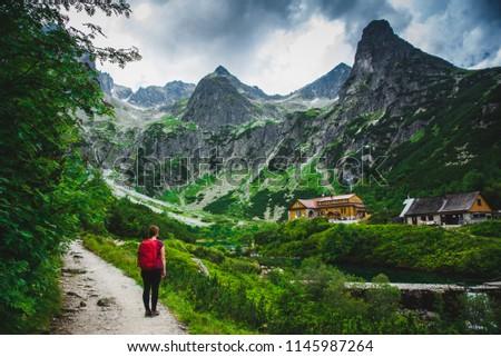 Female Tourist on Touristic trail under wild mountains in Slovakia #1145987264