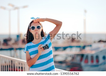 Female Tourist Taking Pictures in a Harbor on Holiday. Surprised woman checking touristic destination photographing everything