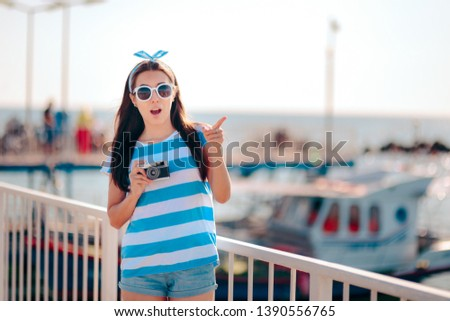 Female Tourist Taking Pictures in a Harbor on Holiday. Surprised woman checking touristic destination photographing everything  #1390556765