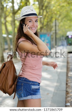 female tourist using mobile phon #1371865709