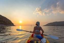 Female tourists canoe in canoeing towards Man Island. Yanui Beach is a small beach close to Promthep cape Viewpoint and there is an Isle of Man in front, making the sea calm and suitable for canoeing