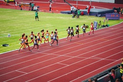 Female track and field race at athletics stadium. Professional female runners. Concept photo for olympic competition in tokyo 2020