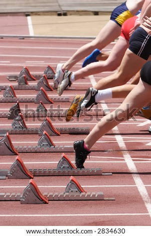 Female track athletes off and racing