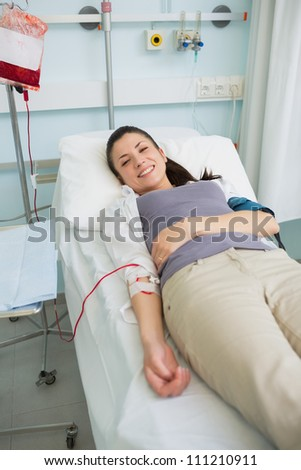 Female transfused patient in hospital ward