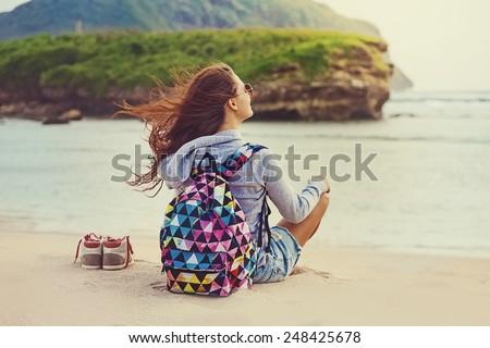 "female traveler admiring a marine view (""instagram"" filter applied)"
