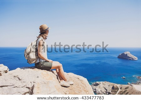 Female traveler looking at the sea, travel and active lifestyle concept #433477783