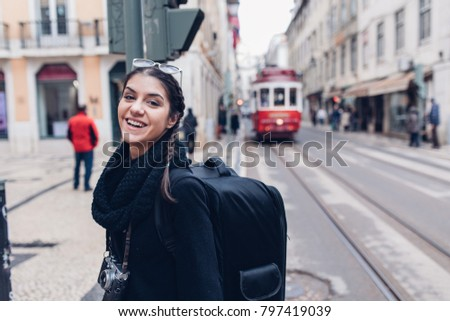 Female traveler woman sightseeing in European capital.Visitor in Lisbon,Portugal.Iconic tram route.Traveling Europe on a budget.Studying abroad.Photography and travel concept #797419039