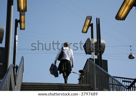 Female traveller leaving Copenhagen Central Station.