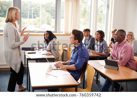 Female Tutor Teaching Class Of Mature Students #760359742