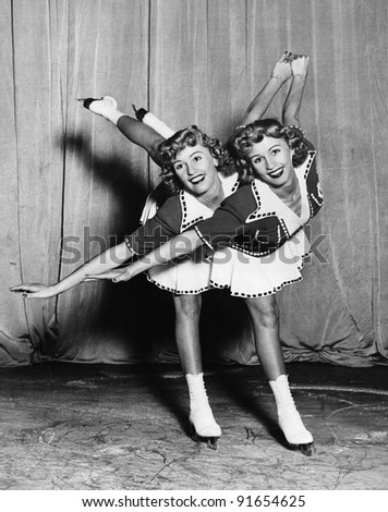 female twin ice skaters
