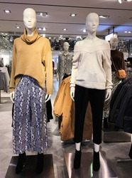 Female two mannequin with winter clothes. Fashion. Shopping.