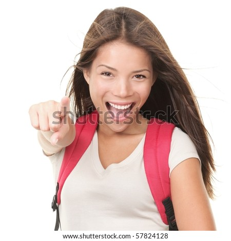 Female university student pointing excited and happy. Isolated on white background. Young mixed white / chinese model wearing school bag.
