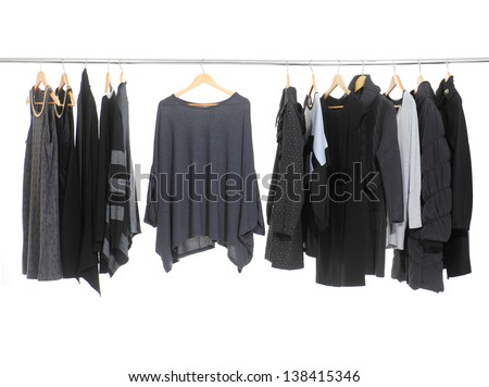 Female Variety of clothes hanging on the rack Stock fotó ©