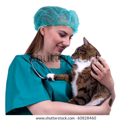 female vet in protective uniform and medical hat with cat in surgery