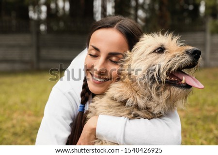 Female volunteer with homeless dog at animal shelter outdoors Foto stock ©
