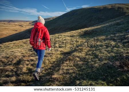 female walker hiking across the ...