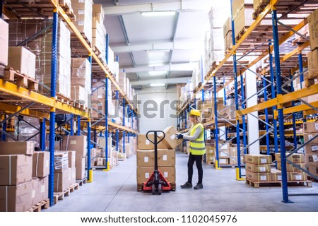 Female warehouse worker loading boxes. #1102045976