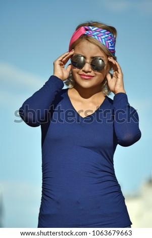 Female Wearing Sunglasses Wearing Sunglasses #1063679663