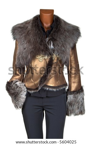 Female winter jacket of gold color decorated by fur