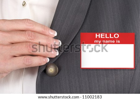 Female with name tag, hello my name is