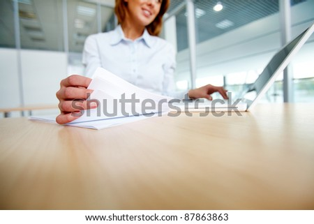 Female with papers busy working in office