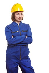 Female worker in blue overall and yellow safety helmet