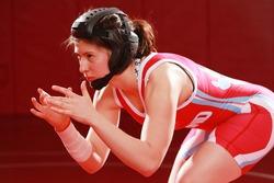 Female wrestler in a singlet and headgear.