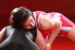 Female wrestler looking to score from a front headlock position