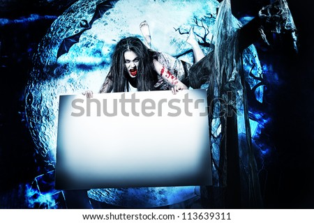 Female zombi flying at the night cemetery in the mist and moonlight and holding white board.