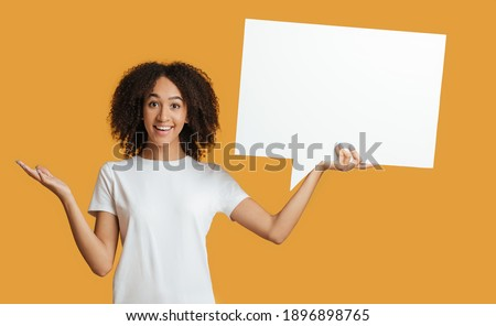 Females thoughts, blogger's tips, advice and recommendations. Happy young african american lady in white t-shirt hold abstract free space for text, isolated on yellow background, studio shot, panorama Stock fotó ©