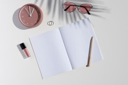Feminine beauty blogger desk. Flat lay mockup with women's accessories, trendy palm leaf shadows and opened blank notebook. Copy space for text