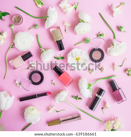 Feminine desk with woman cosmetics and white flowers on pink background. Flat lay, top view. Beauty concept for blog #639186661