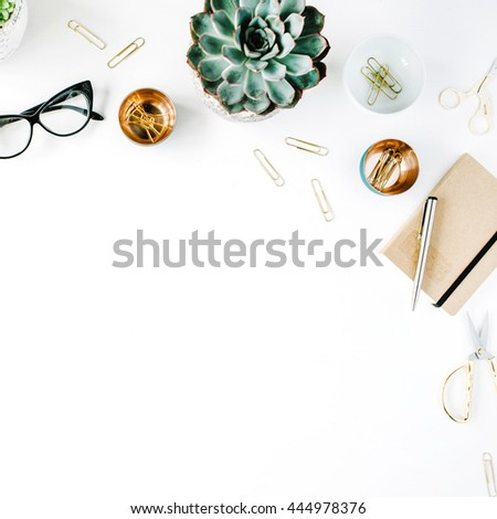feminine desk workspace with succulent, retro camera, scissors, diary, glasses and golden clips on white background. flat lay, top view