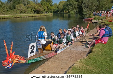 FEN DITTON, CAMBRIDGE, UK - SEPT. 12: An unidentified team prepares for a race at charity dragon boat festival  September 12, 2009 in Fen Ditton, Cambridge, UK