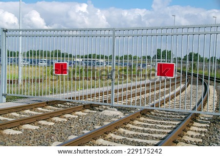 Fence across the railroad