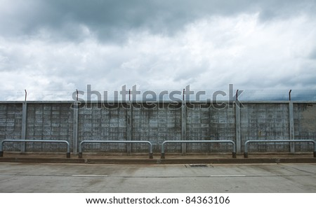 Fence beside of road.