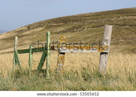 stock-photo-fence-doors-made-from-wood-in-the-middle-of-the-meadow-old-and-broken-yet-standing-53505652.jpg