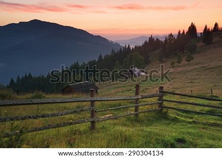 Fence in mountain valley. Agricultural landscape during sunrise. #290304134