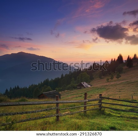 Fence in mountain valley. Agricultural landscape during sunrise. #291326870