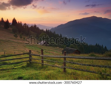 Fence in mountain valley. Agricultural landscape during sunrise. #300760427
