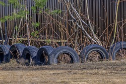 Fence made of old tires close-up