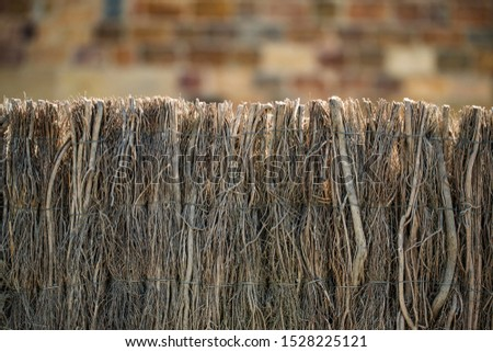 fence of binded branches background #1528225121