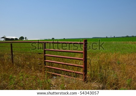 fence on border of crop field