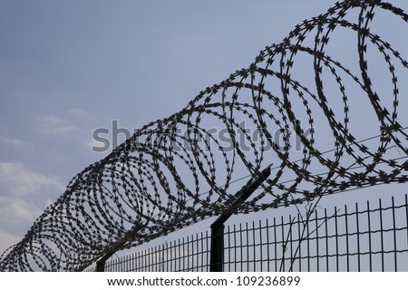 Arrow fence spike for securing house or… Stock Photo 413774197